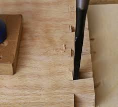 dovetail chisel. angled chisel cutting dovetail joints