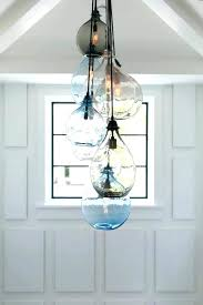 cool foyer chandeliers look other metro beach style entry decorators with architectural photographer photography lighting