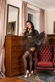 Breath taking milf Katie Smith wears ultra sexy black lingerie and.
