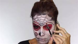 brush red on forehead easy day of the dead makeup tutorial perfect for