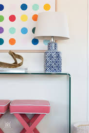 curved glass table with white walls console table decor ideas