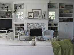 love the built in shelves and the photos on fireplace