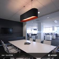 oval pendant lighting collection satelight long oval shaped lamp shade hanging over office meeting