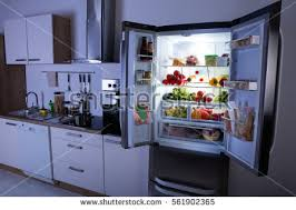 open refrigerator. open refrigerator full of healthy items in modern kitchen e