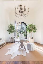 alyssa rosenheck round french foyer table on white cowhide rug