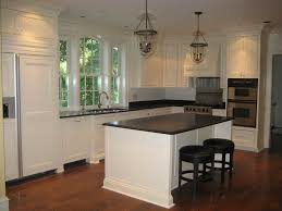 Granite Island Kitchen White Cabinets With Chunky Crown Moulding And Huge Window Over