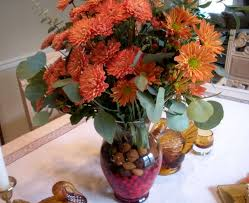 Thanksgiving Floral Arrangementplace fresh cranberries in the bottom of  your vase for a seasonal