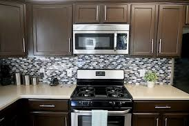 painted cabinets in kitchenRemodelaholic  Sleek Dark Chocolate Painted Cabinets