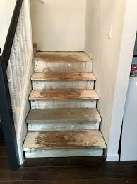 carpet laminate stairs. we ripped the carpet out immediately, then redid floors, but lived with stairs like this for months. first thing you see when walk in laminate y