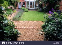 Small Picture Small back garden lawn border hedge brick and gravel path Rosa