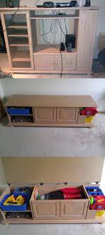 Old Entertainment Center turned into Child's Toy box! Or blanket storage.