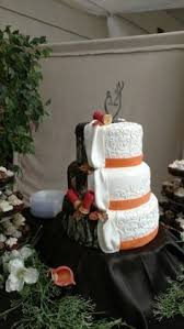winter camo wedding cake i created this for my brother's wedding Wedding Hunters Food Network camo wedding cake with his and hers side and shot gun shells Hunter Foods Anaheim CA