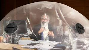 disheveled cdc director warns of invisible germs crawling everywhere from inside sealed plastic bubble