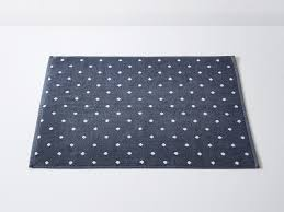 at 50x70cm this polka dot bath mat is small but has good absorbency and a thickness of 700gsm unlike er mats which are polyester or a polyester mix