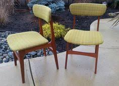 2 mid century teak dining chairs