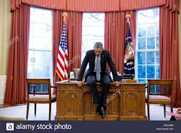 white house oval office desk. U.S. President Barack Obama Sits On His Desk At The White House Oval Office February 23 O