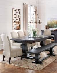 dress up the dining table with skirted upholstered dining chairs