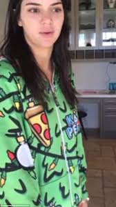 fashion statement kendall jenner also wore a tree themed onesie just like her sister kylie