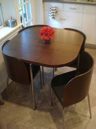 A table where the chairs fit perfectly into works perfect for ...