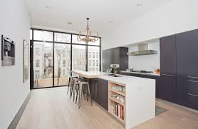awesome black and white paint and color idea for kitchen with silver stools set under decorative gold chandelier design