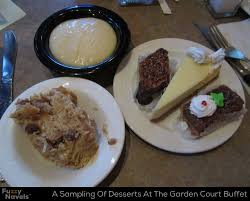 five desserts including bread pudding and cheesecake at the main street station buffet as posted by justin in garden court buffet