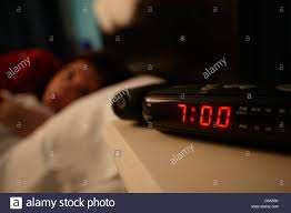 Awesome Alarm Clock Early Morning With Early Twenties Woman Lying In Bed In A  Bedroom