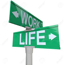 a green two way street sign pointing to the words work and life a green two way street sign pointing to the words work and life symbolizing