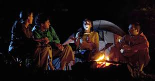 camping in the woods at night. Contemporary Woods Sitting Around The Campfire At Night With A Su0027more In One Hand  Flashlight Other Listening To Someone Recount Chilling Tale Woods And Camping In The Woods At Night T