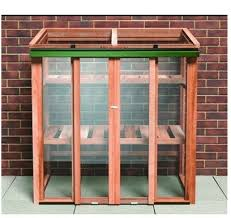 this cold frame is a real beauty constructed from wood and with toughened glass panels it will protect plants and seedlings wver the weather so your
