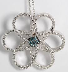 diamond flower pendant in 18k white gold setting with 115 blue white diamond equaling 0 98