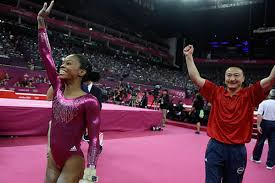 floor gymnastics gabby. Gabby Douglas Waves To The Audience After Her Final And Deciding Performance On Floor, Followed By Coach Liang Chow During Artistic Gymnastics Floor