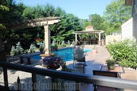 Enhancing poolside decor is easily done by putting down flowers in planters.