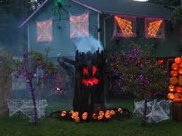 use rope lights to create a giant scary spider web. Halloween decorating  with lights!