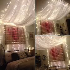 lighting curtains. fairy light bed canopy hung from ceiling to give effect of four poster i used lighting curtains r
