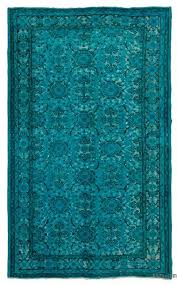 turquoise hand carved over dyed rug 5 5 x 9