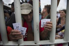 a honduran migrant held tickets that let him and his family cross into mexico on saay