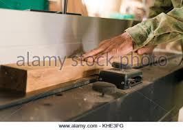 hand jointer planer. hand using electric planer and wooden beam - stock photo jointer d