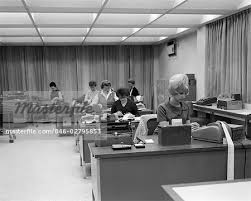 office furniture women. 1960s 6 WOMEN AT DESKS IN ACCOUNTING OFFICE INTERIOR ADDING MACHINES - Stock Photo Office Furniture Women R