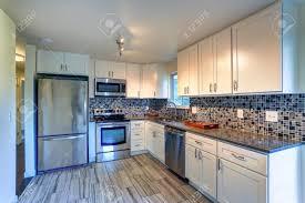 kitchen backsplash white cabinets brown countertop. L-shape Kitchen Room Design With White Cabinets, Brown Granite Countertops, Mosaic Backsplash Cabinets Countertop A