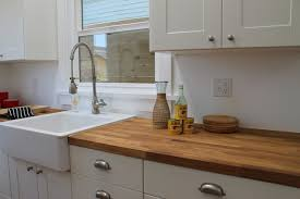 Apron Front Farm Sink and Industrial Faucet in Modern Bungalow
