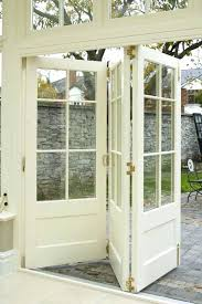 glass over panel wood interior bi fold door stained