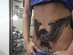 татуировка на животе у девушки орел фото рисунки эскизы