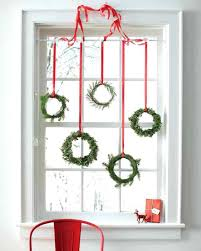 hanging pictures with ribbon ideas view in gallery tiny wreaths hung with red ribbon in a