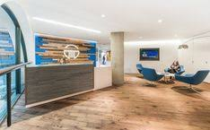 Office lobby decorating ideas Waiting Coalesse Bob Chairs Welcome Visitors Into The Office Lobby Of Tempus Consulting Offices Lobby Reception Chapbros 176 Best Office Lobby Designs Images Entry Way Design Lobby