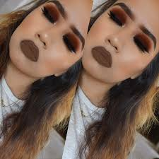 autumn inspired makeup look full of burgundy red makeup forever eyeshadow tones perfect for fall black eyeliner and a nice bold lip