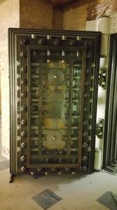 inside of an old bank vault door approximately 8 feet tall and 18 inches thick