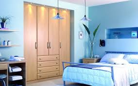 Luxury Blue Bedroom Color Combined With Wooden Wardrobe Cabinet And A Pair  Of Classical Pendant Lamp And Green Natural Plant Create Natural Nuance