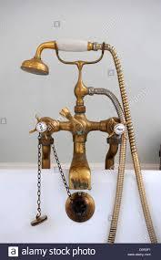 style antique brass bath taps an antique brass mixer tap and shower head on a bath uk