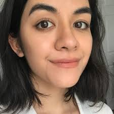 woman with olive skin tone wearing shimmery makeup and a nomakeup makeup look