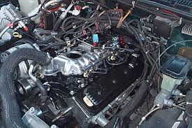 gm performance view topic vortec l marine manifold project q a see pic the valve will sit higher than before but the harness will reach and the hood clears plenty of room to spare 5